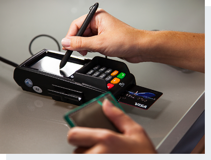 customer processing their credit card and confirming their purchase with a signature on a payment terminal