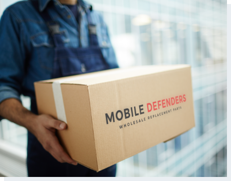 Manufacture worker carrying a Mobile Defenders package